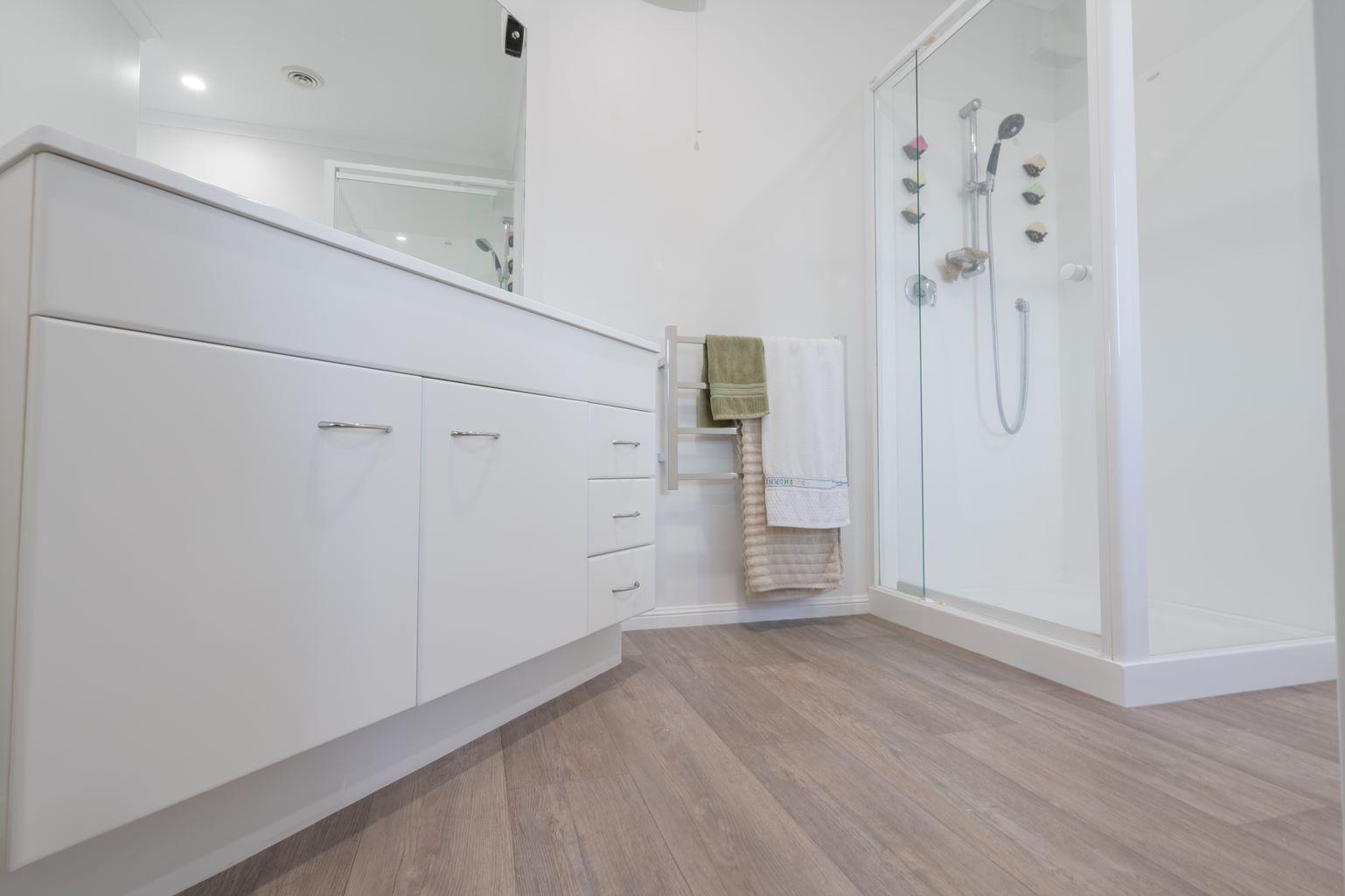 vinyl flooring in bathroom - beach house renovation